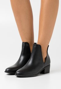 Rubi Shoes by Cotton On - EASTWOOD CUT OUT - Ankle boots - black - 0