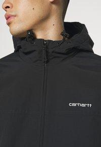 Carhartt WIP - HOODED SAIL JACKET - Välikausitakki - black/white - 6