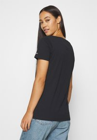 Tommy Jeans - CHEST SIGN OFF V NECK TEE - T-shirt basique - black