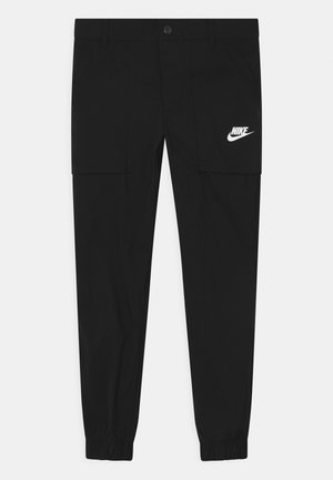 WILD CARD - Trousers - black/white