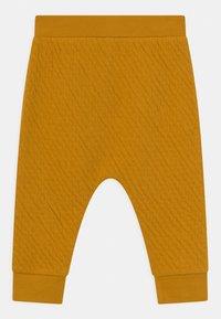 Sense Organics - NALU BABY UNISEX - Trousers - mustard - 1