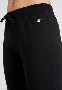 Champion - CUFF PANTS - Tracksuit bottoms - black - 4