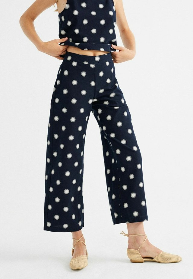 BEGONIA - Trousers - soles