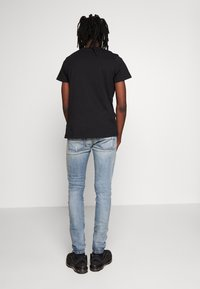 Diesel - D-AMNY-X - Slim fit jeans - blue denim - 2