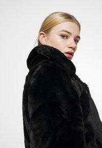 Vero Moda - VMTHEA BIKER JACKET - Winter jacket - black - 4