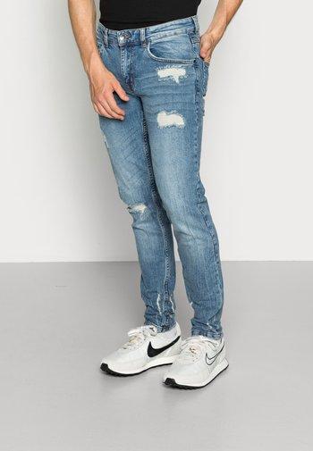 STOCKHOLM DESTROY - Jeans slim fit - soft blue