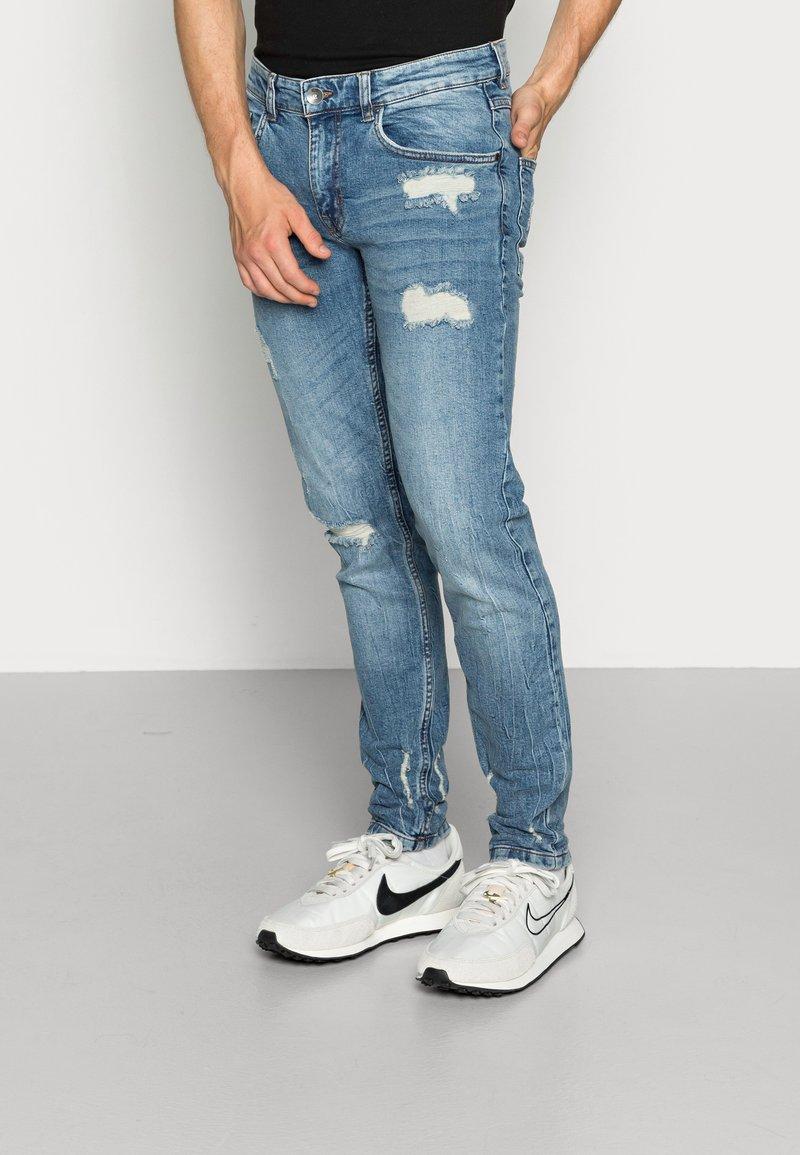 Redefined Rebel - STOCKHOLM DESTROY - Jeans slim fit - soft blue
