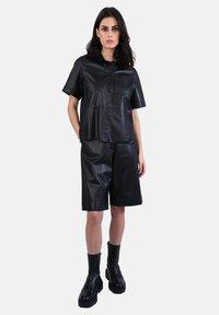 Oakwood - CITY - Leather trousers - black - 1