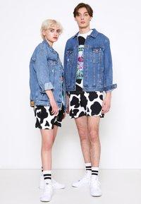 AS IF Clothing - UNISEX COWDELIC  - Shorts - black/white - 1