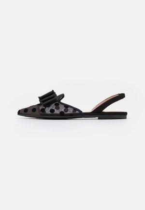 MARA - Sandals - black/transparente
