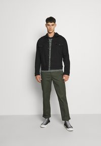Levi's® - THE TRUCKER JACKET - Spijkerjas - blacks - 1