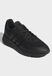 adidas Originals - ZX 1K BOOST SCHUH - Sneakers - black - 2