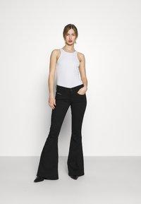 Diesel - BLESSIK  - Flared Jeans - black - 1