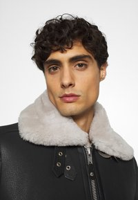 Schott - Leather jacket - black/offwhite - 3