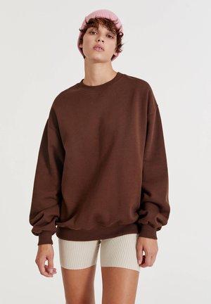 Collegepaita - mottled light brown