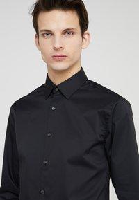 Tiger of Sweden - FILBRODIE EXTRA SLIM FIT - Formal shirt - black - 4