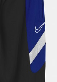 Nike Performance - DRY ACADEMY - Tracksuit bottoms - black/deep royal blue/white - 2