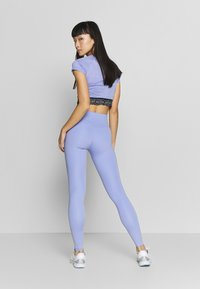 Nike Performance - ONE LUXE - Tights - light thistle/clear - 2