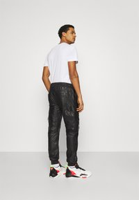 Tigha - TANO - Leather trousers - black - 2