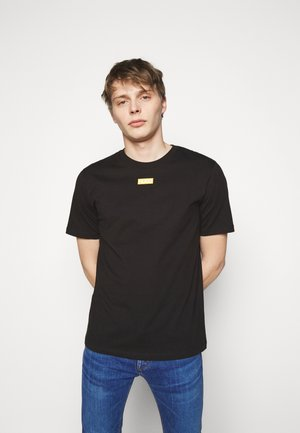 DURNED - Basic T-shirt - black