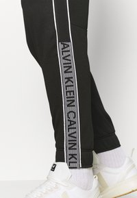 Calvin Klein Performance - PANT - Tracksuit bottoms - black/bright white - 3