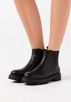 RAYANE - Platform ankle boots - black