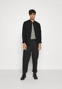 Tigha - PHARRRELL - Overhemd - black - 1
