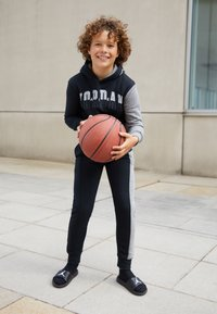 Jordan - AIR SPECKLE PANTS - Pantaloni sportivi - black - 1