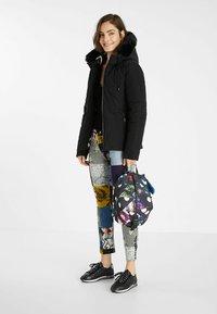 Desigual - SLIM PADDED JACKET HOOD - Winter jacket - black - 1