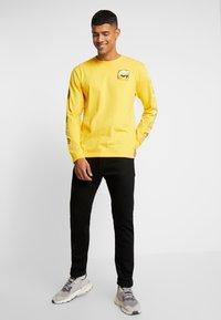 Edwin - SLIM TAPERED - Slim fit jeans - rinsed kaihara black - 1