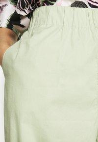 Monki - VILJA TROUSERS - Trousers - green dusty light - 4