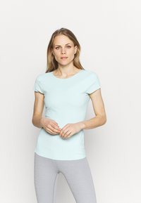Nike Performance - THE YOGA LUXE - Basic T-shirt - teal tint/barely green - 0