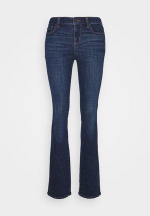 SKINNY KICK - Jeans a zampa - dark ink