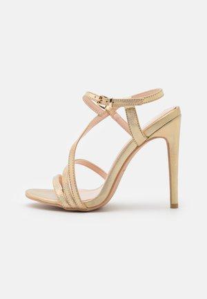 DERELLA - Sandals - gold