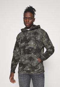 Levi's® - RELAXED FIT LOGO HOODIE UNISEX - Hoodie - black - 0