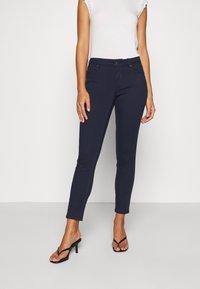 Vero Moda Petite - VMHOT SEVEN SLIM PUSH UP PANTS - Trousers - navy blazer - 1