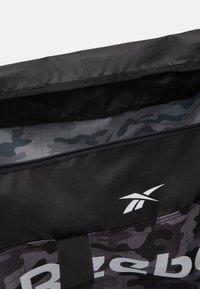 Reebok - ACT CORE GRIP UNISEX - Sports bag - black - 4