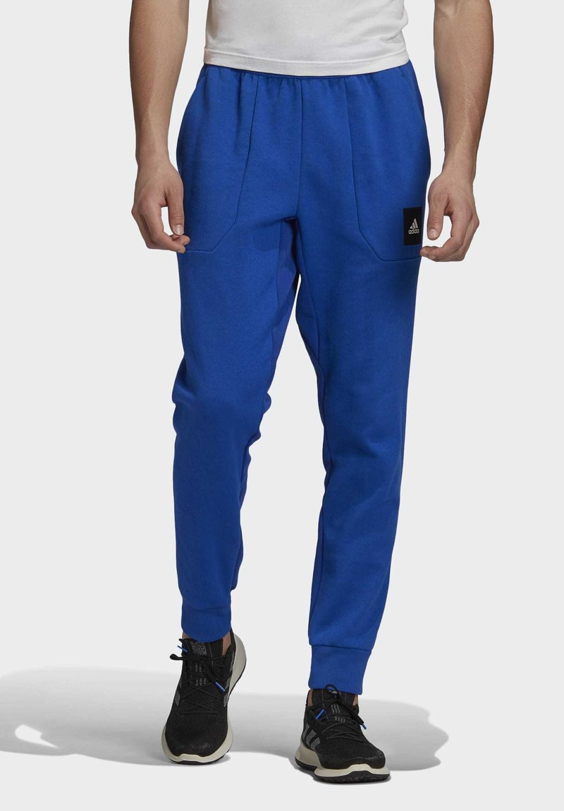 adidas Performance - MUST HAVES STADIUM TRACKSUIT BOTTOMS - Pantalones - blue