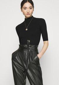 Vero Moda - VMEVA PAPERBAG ANKLE PANTS - Trousers - black - 3