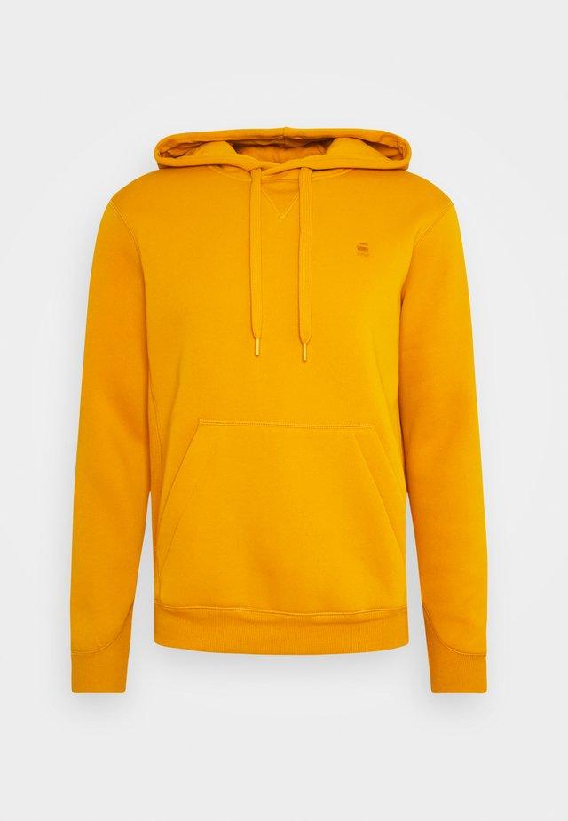 PREMIUM CORE hooded long sleeve - Kapuzenpullover - dark gold