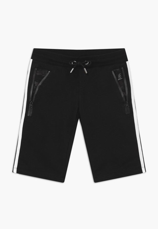 BOYS  - Tracksuit bottoms - black