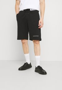 Calvin Klein Jeans - TAPE - Shorts - black - 0