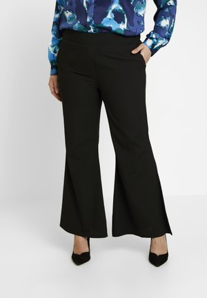 STATEMENT WIDE PLAIN - Trousers - black