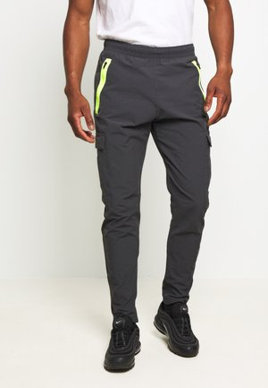 FESTIVAL - Tracksuit bottoms - smoke grey/volt