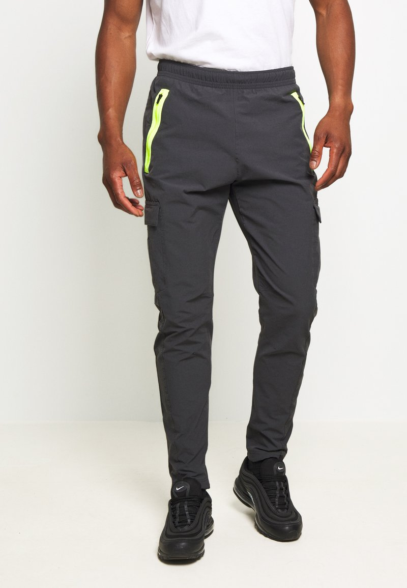 Nike Sportswear - FESTIVAL - Tracksuit bottoms - smoke grey/volt
