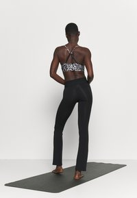 Deha - FIT PANTS - Leggings - black
