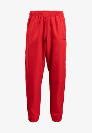 CARSON PANTS - Tracksuit bottoms - red/blue