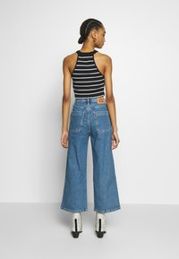 Levi's® - MILE HIGH BUTTONS - Jean flare - stoned out