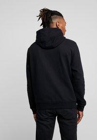 Calvin Klein - TEXT LOGO HOODIE - Hoodie - black - 2