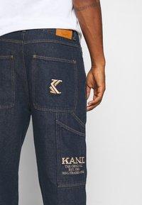 Karl Kani - RINSE PANTS - Džíny Straight Fit - navy - 4